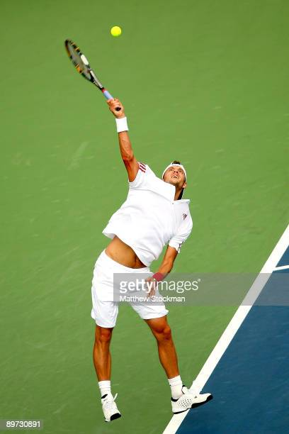 Paul-Henri Mathieu of France serves to Guillermo Garcia-Lopez of Spain during the Rogers Cup at Uniprix Stadium August 10, 2009 in Montreal, Quebec,...