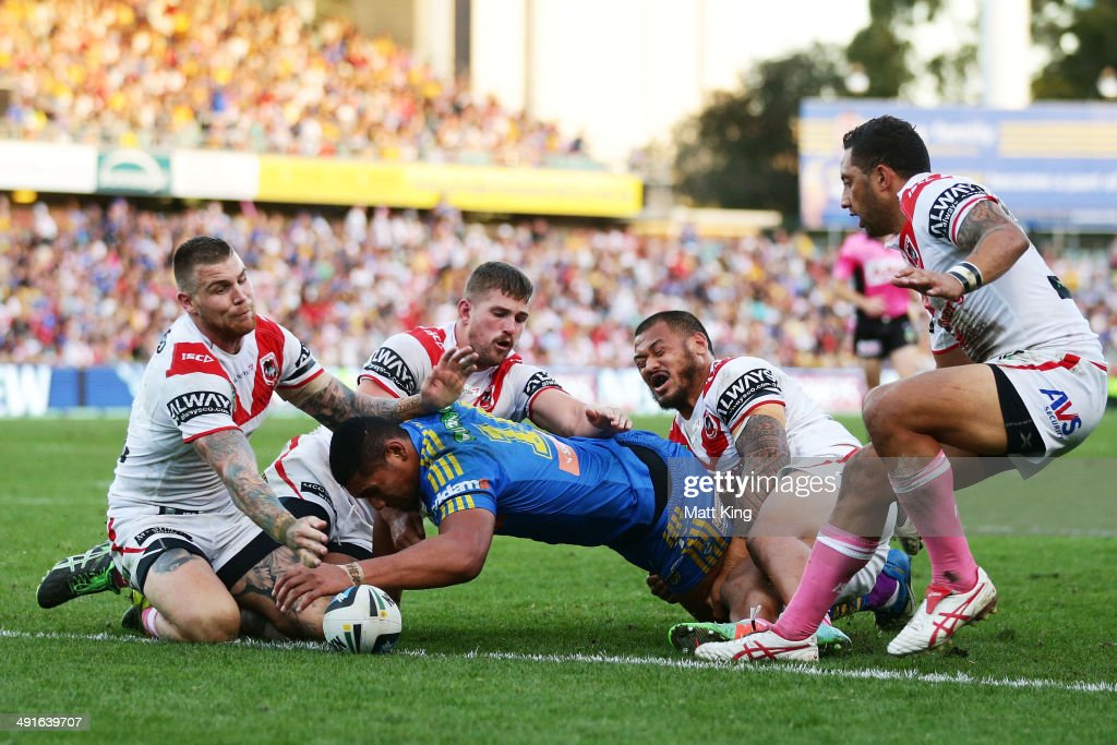 Pauli Pauli of the Eels scores a try during the round 10 NRL match between the Parramatta Eels and the St George Illawarra Dragons at Pirtek Stadium on May 17, 2014 in Sydney, Australia.