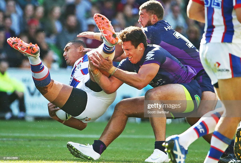 Pauli Pauli of the Knights is tackled during the round five NRL match between the Melbourne Storm and the Newcastle Knights at AAMI Park on April 2, 2016 in Melbourne, Australia.