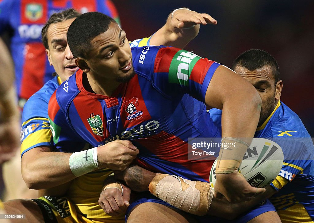 Pauli Pauli of the Knights looks to pass the ball during the round 12 NRL match between the Newcastle Knights and the Parramatta Eels at Hunter Stadium on May 30, 2016 in Newcastle, Australia.