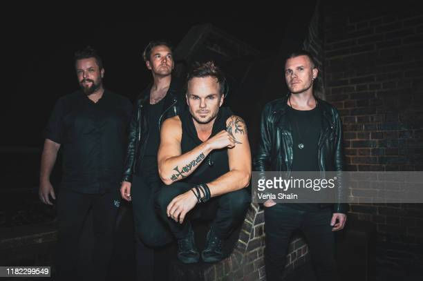 Pauli Rantasalmi, Eero Heinonen, Lauri Ylonen and Aki Hakala of The Rasmus pose backstage at O2 Forum Kentish Town on October 12, 2019 in London,...