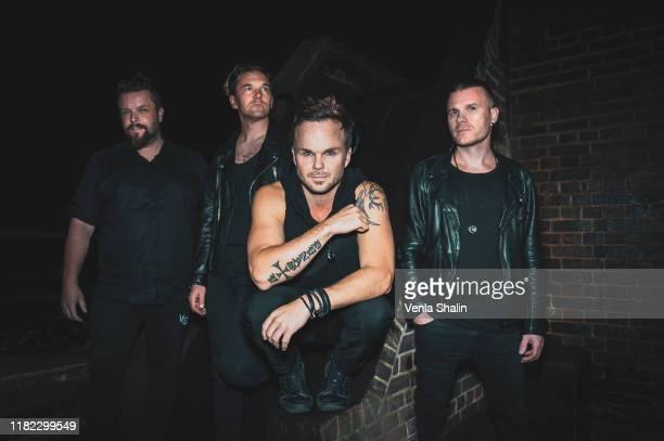 Pauli Rantasalmi, Eero Heinonen, Lauri Ylonen and Aki Hakala of The Rasmus pose backstage at O2 Forum Kentish Town on October 12, 2019 in London,...