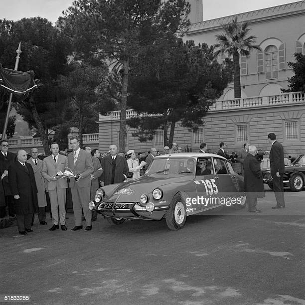 Pauli Toivonen and Ensio Mikander winners of 35th Rally of MonteCarlo hold 22 January 1966 in Monaco trophies in front of their Citroen DS21 at the...