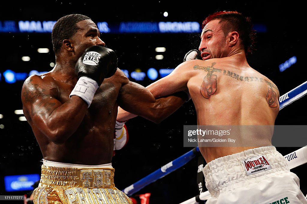 Paulie Malignaggi and Adrien Broner exchange blows during their WBA Welterweight Title bout at Barclays Center on June 22, 2013 in the Brooklyn borough of New York City.