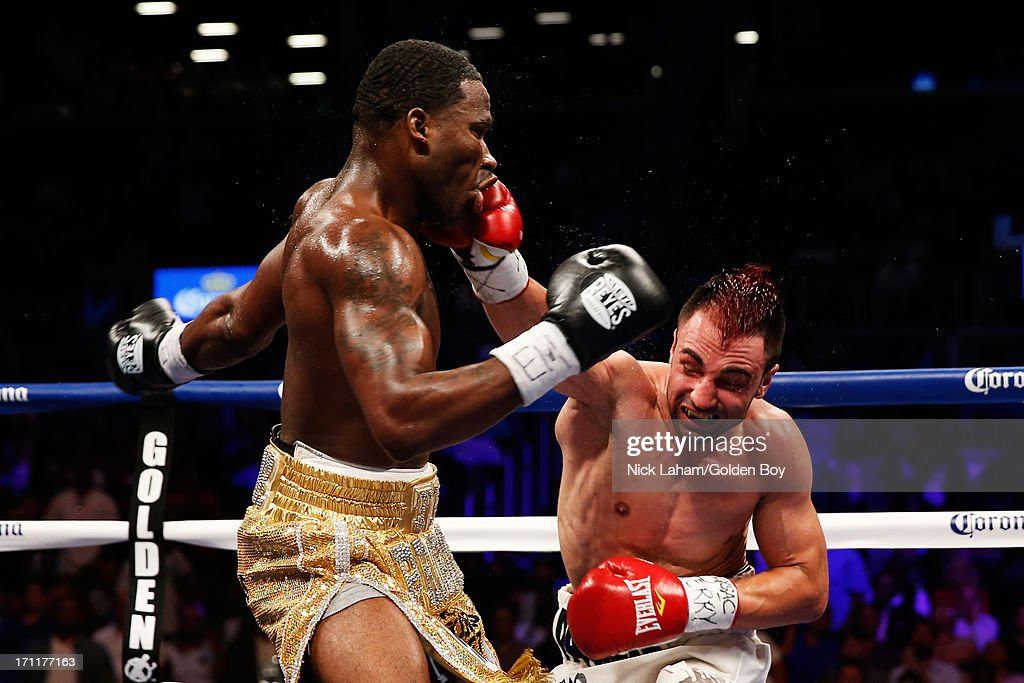 Paulie Malignaggi (R) lands a punch on Adrien Broner during their WBA Welterweight Title bout at Barclays Center on June 22, 2013 in the Brooklyn borough of New York City.
