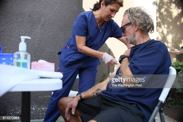 Paulina Bobenrieth a nurse with the HHSA Public Health dept gives a Hepatitis A vaccine to a Homeless person in Downtown San Diego CA on Wednesday...
