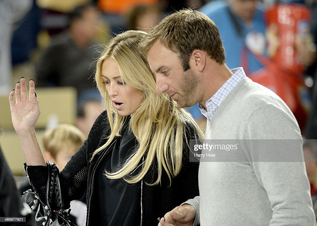 Paulina Gretzky and Dustin Johnson attend the game between the Los Angeles Kings and the Anaheim Ducks during the 2014 Coors Light NHL Stadium Series at Dodger Stadium on January 25, 2014 in Los Angeles, California.