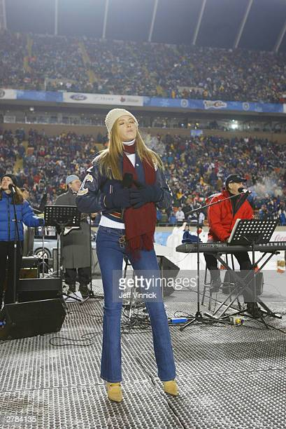 Paulina Gretzky daughter of hockey legend Wayne Gretzky sings 'I Will Remember You' before the Edmonton Oilers take on the Montreal Canadiens during...