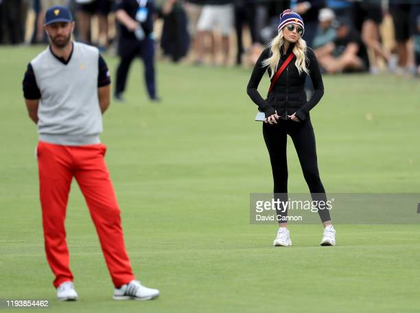 Paulina Gretzky the girlfriend of Dustin Johnson watches the golf during the afternoon fourball matches in the 2019 Presidents Cup at Royal Melbourne...