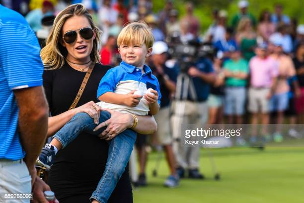Paulina Gretzky wife of Dustin Johnson carries their son Tatum after Dustin's 1up victory during the championship match at the World Golf...