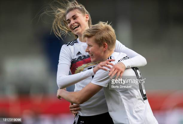Paulina Krumbiegel of Germany celebrates with teammates after scoring her team's third goal during the Women's International Friendly match between...