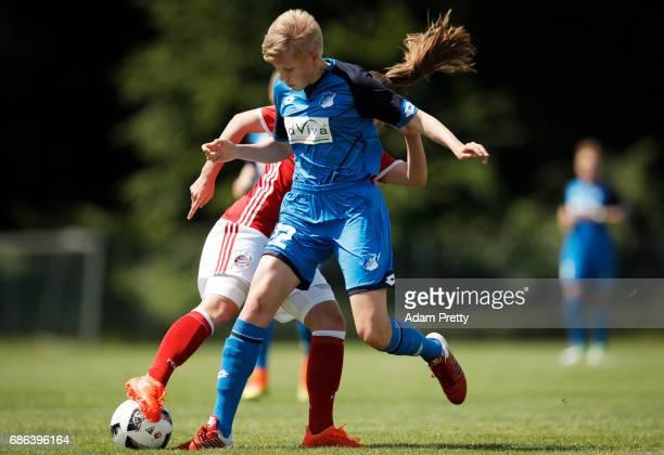 Paulina Krumbiegel of Hoffenheim II is challenged by Stefanie Reischmann of FC Bayern Munich II during the match between 1899 Hoffenheim II and FCB...