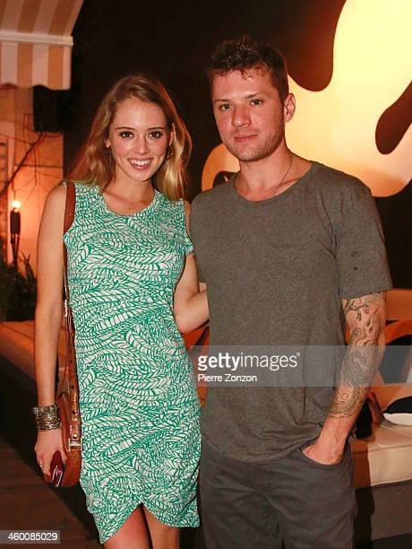 Paulina Slagter and actor Ryan Phillippe pose for a photo at Salt and Pepper on January 1 2014 in Miami Florida