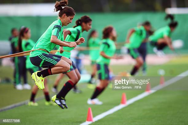 Paulina Solis and team mates exercise during a Mexico training session at Moncton stadium on August 4 2014 in Moncton Canada