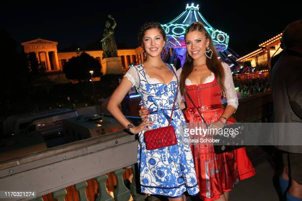 """Paulina Swarovski and sister Victoria Swarovski during the """"Almauftrieb"""" as part of the Oktoberfest 2019 at Kaefer Tent at Theresienwiese on..."""