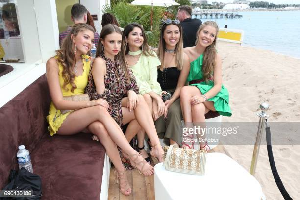Paulina Swarovski and Victoria Swarovski attend Magnum photocall during the 70th annual Cannes Film Festival at Magnum Beach on May 18 2017 in Cannes...