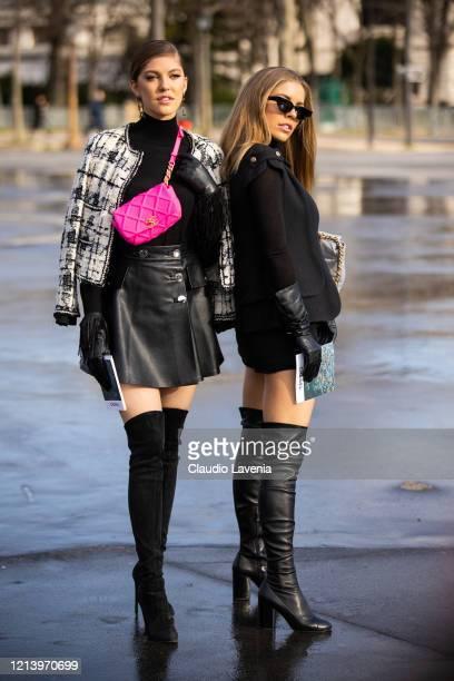 Paulina Swarovski and Victoria Swarovski, wearing a black turtleneck top, black mini skirt, black and white jacket, Chanel fuchsia bag, black gloves...