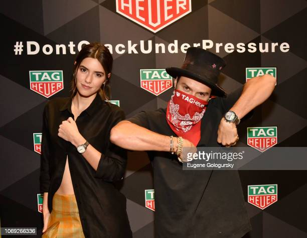 Paulina Vega and Alec Monopoly attend the TAG Heuer celebration of Art Basel Miami 2018 with the launch of Alec Monopoly's special edition timepieces...