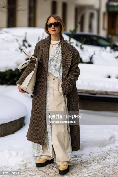 Paulina Vinter in Hope Stockholm and ATP Atelier poses for a picture outside of Hotel Diplomat on the second day of Stockholm Fashion Week...