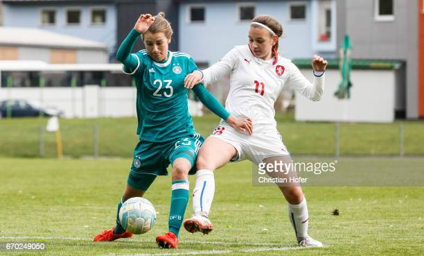 Pauline Annette Machtens of Germany challenges Andre Hola of Czech Republic for the ball during the Under 15 girls international friendly match...
