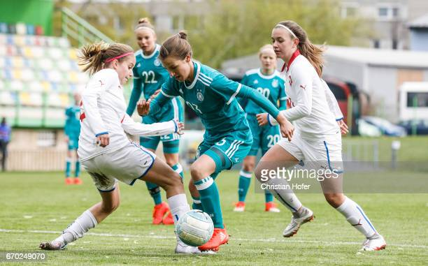 Pauline Annette Machtens of Germany challenges Aneta Sovakova and Andre Hola of Czech Republic for the ball during the Under 15 girls international...