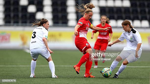 Pauline Berning of Guetersloh challenges Vanessa Ziegler of Freiburg during the U17 Girl's German Championship Semi Final Second Leg match between...