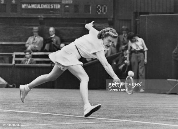 Pauline Betz of the United States reaches to make a backhand return to Josane de Meulemeester of Belgium during their Women's Singles Second Round...