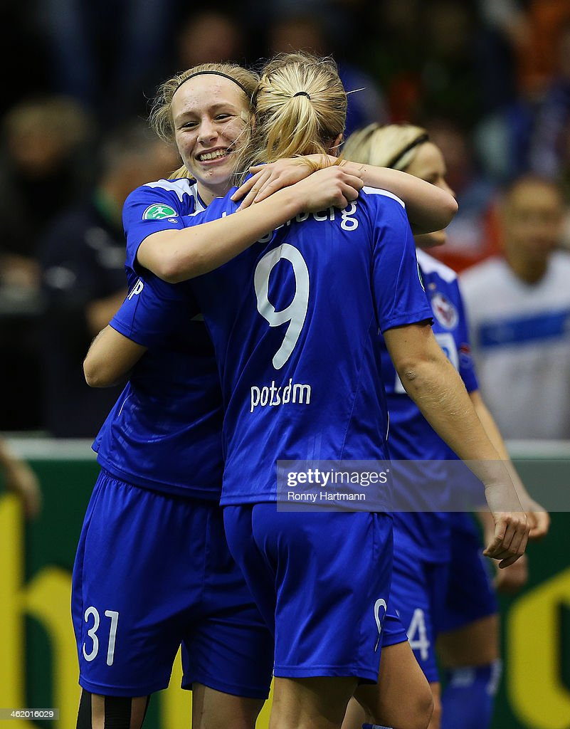Pauline Bremer (L) and Ada Hegerberg of 1. FFC Turbine Potsdam celebrate during the DFB Women's Indoor Cup 2013 at GETEC-Arena on January 12, 2014 in Magdeburg, Germany.