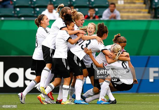 Pauline Bremer of Germany celebrates after her goal against China PR with her team at Commonwealth Stadium on August 8 2014 in Edmonton Canada