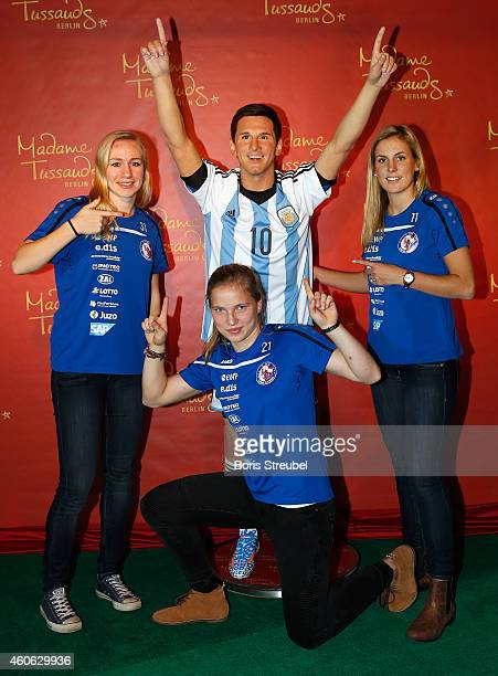 Pauline Bremer Tabea Kemme and Jennifer Cramer of the women's national football team of Germany unveil a wax figure of the multiple world player of...