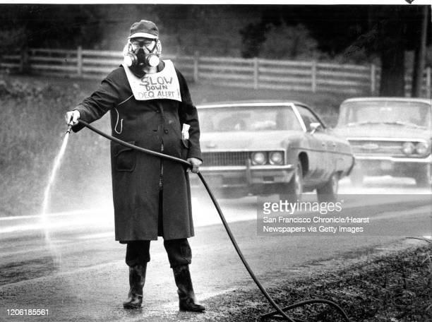 Pauline Broge in Beaverton Oregon, try clean up the road of Mount St. Helens volcano ash June 15, 1980 Photo ran , P. 1