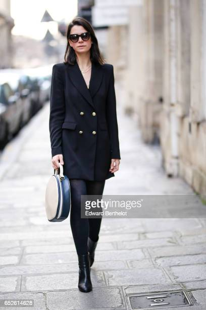 Pauline Darris Founder of the Darris accessories brand wears Spektre sunglasses a Zara black blazer jacket Other Stories boots and a Darris bag on...