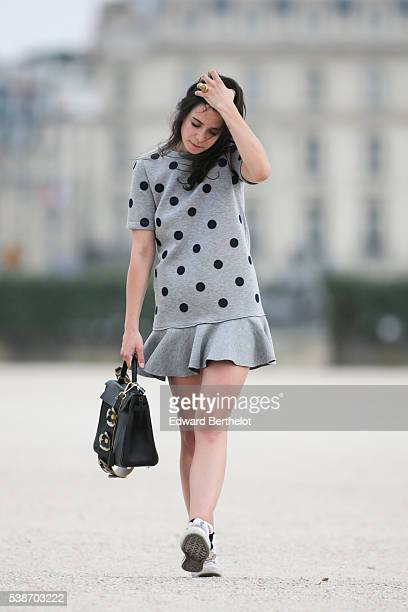 Pauline Darris is wearing a Vanessa Bruno dress a Hermes Kelly bag a Darris bag handle Converse shoes and a Darris shoe tongue during a street style...