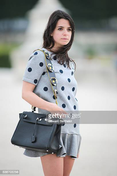Pauline Darris is wearing a Vanessa Bruno dress a Hermes Kelly bag and a Darris bag handle during a street style session on June 07 2016 in Paris
