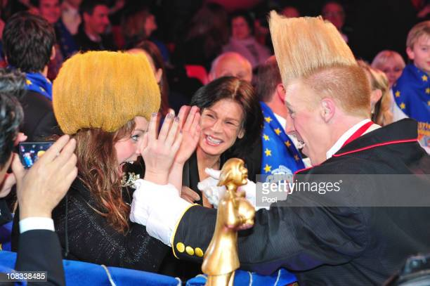 Pauline Ducruet is presented with a performer's hat as Princess Stephanie of Monaco watches on as they attend the awards ceremony for the 35th...
