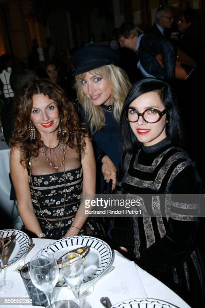 Pauline Lefevre standing between Members of Musical Group 'Brigitte' Aurelie Saada and Sylvie Hoarau attend the 'Diner des Amis de Care' at Hotel...