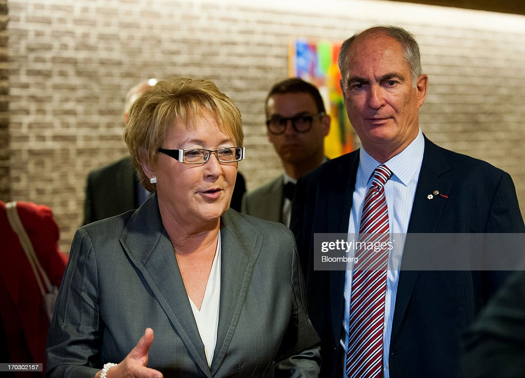 Pauline Marois, premier of Quebec, left, and Gil Remillard, founding chairman of the International Economic Forum of the Americas, speak to attendees during the Conference Of Montreal in Montreal, Quebec, Canada, on Monday, June 10, 2013. The Conference of Montreal brings together Heads of State, the private sector, international organizations and civil society to discuss major issues concerning economic globalization, focusing on the relations between the Americas and other continents. Photographer: David Vilder/Bloomberg via Getty Images