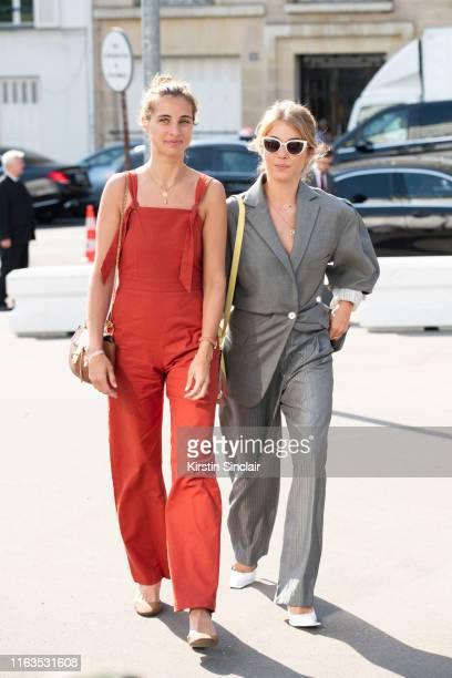Pauline MayaPerez wears an orange jumpsuit with Actress Alice Isaaz wearing all Acne Studios on June 30 2019 in Paris France