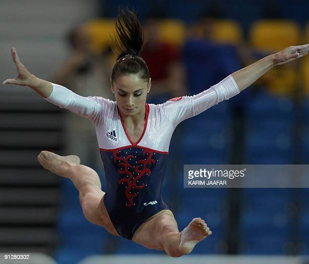 Pauline Morel of France competes in the beam event during the second Doha Gymnastics World Cup at the Aspire Academy in the Qatari capital on...