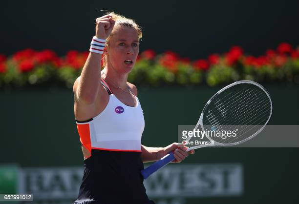 Pauline Parmentier of France celebrates a point against Angelique Kerber of Germany in their third round match during day eight of the BNP Paribas...