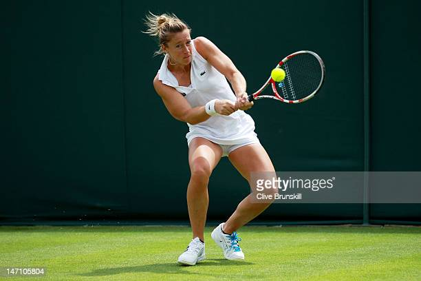 Pauline Parmentier of France hits a backhand return during her ladies' singles first round match against Sorana Cirstea of Romania on day one of the...