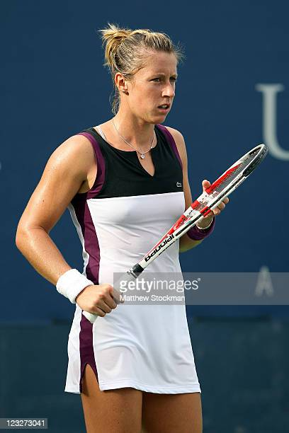 Pauline Parmentier of France looks on during a break in play against Akgul Amanmuradova of Uzbekistan during Day Four of the 2011 US Open at the USTA...