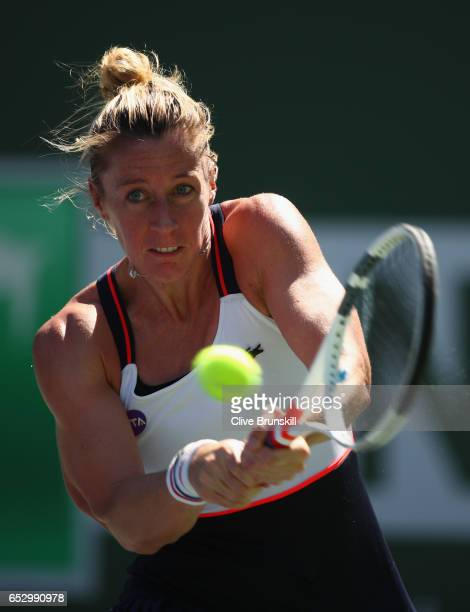 Pauline Parmentier of France plays a backhand against Angelique Kerber of Germany in their third round match during day eight of the BNP Paribas Open...