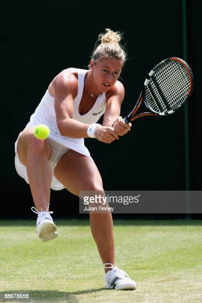 Pauline Parmentier of France plays a backhand during the women's singles second round match against Svetlana Kuznetsova of Russia on Day Four of the...