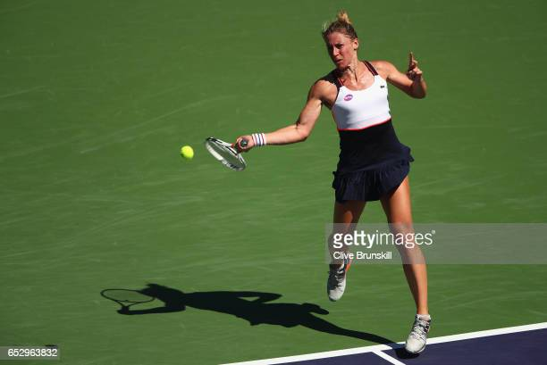 Pauline Parmentier of France plays a forehand against Angelique Kerber of Germany in their third round match during day eight of the BNP Paribas Open...