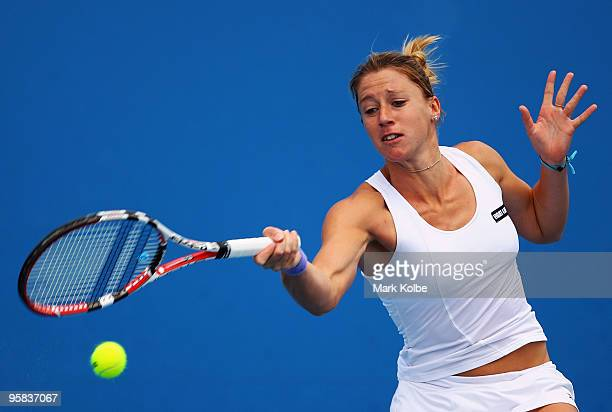 Pauline Parmentier of France plays a forehand in her first round match against Elena Baltacha of Great Britain during day one of the 2010 Australian...