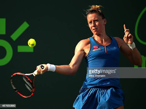 Pauline Parmentier of France plays a match against Samantha Stosur of Australia during Day 4 of the Miami Open presented by Itau at Crandon Park...