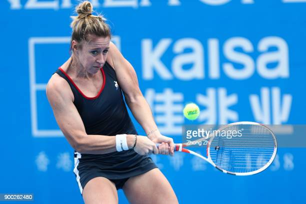 Pauline Parmentier of France returns a shot during the match against Zarina Diyas of Kazakhstan during Day 2 of 2018 WTA Shenzhen Open at Longgang...