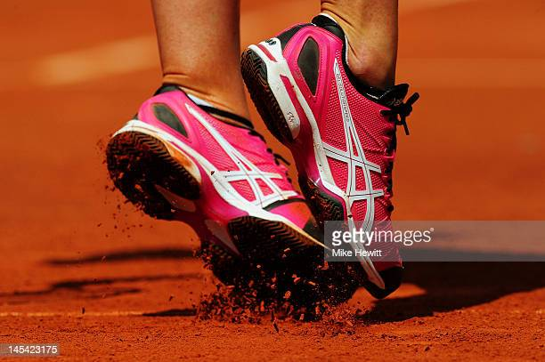 Pauline Parmentier of France's shoes kick up loose clay from the court as she serves during the women's singles first round match between Pauline...