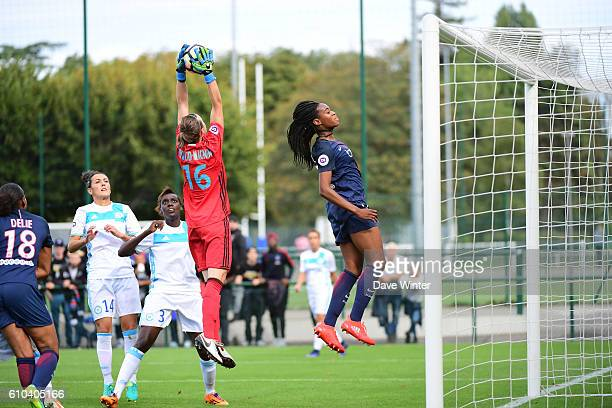 Pauline Peyraud Magnin of Marseille gathers the ball under pressure from Marie Antoinette Katoto of PSG during the women's French D1 league match...